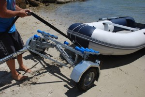 Loading an inflatable boat onto the Bulldog Folding Boat Trailer