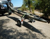 Side on view of trailer carrying a kayak